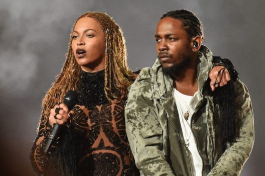 LOS ANGELES, CA - JUNE 26:  Singer Beyonce (L) and rapper Kendrick Lamar perform onstage during the 2016 BET Awards at the Microsoft Theater on June 26, 2016 in Los Angeles, California.  (Photo by Paras Griffin/BET/Getty Images for BET)